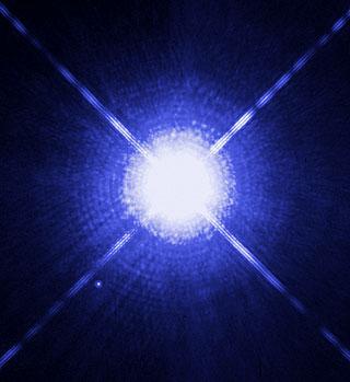 Сириус А и много по-слабата Сириус B. Новата теория на Хофман и неговите колеги ще помогне да бъде разбран спектъра на белите джуджета. Снимка: NASA/ESA