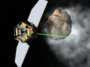 Кадър от видео на НАСА показващо как притеглящ лъч може да се използва за да се вземе проба от космически обект.  Новия прототип разработен от британски и чешки учени може да превърне тази визия в реалност.