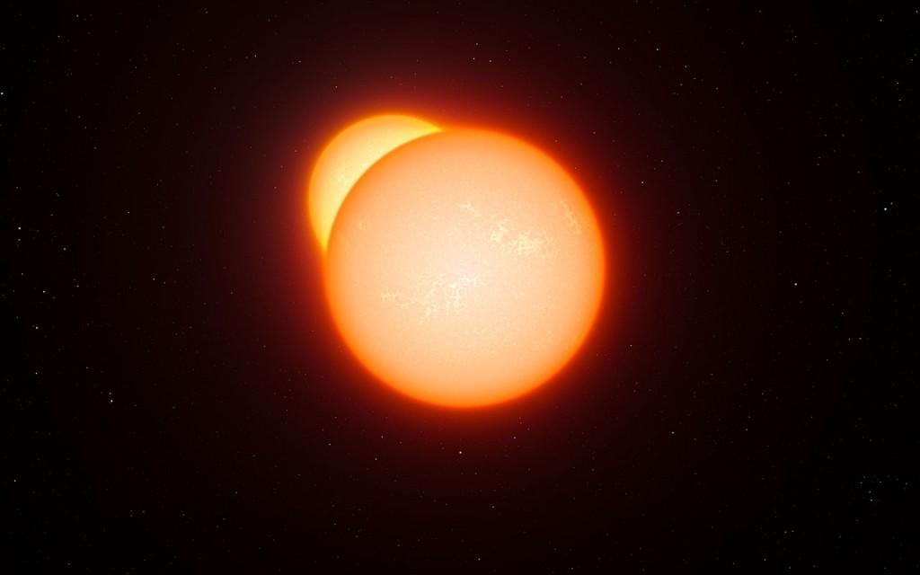 Художествена концепция за затъмняваща се двойна система. Този рядък клас звездни системи са използвали учените за да определят разстоянието до Големия Магеланов облак. Изображение: ESO