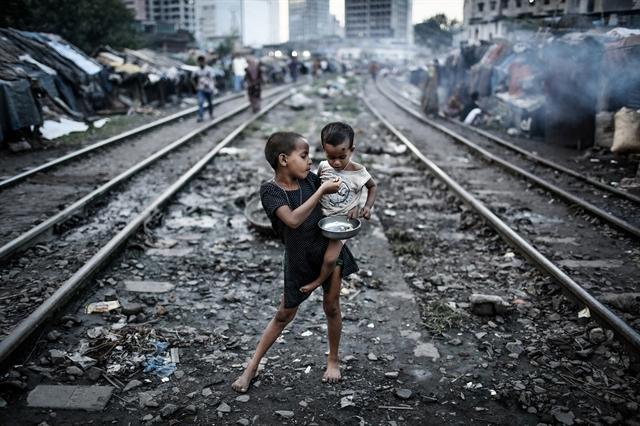Тази снимка е направена в квартала Калранбазар в Дака, Бангладеш. Снимка: © Turjoy Chowdhury, Bangladesh, Winner, Environment, Youth Award, 2014 Sony World Photography Awards