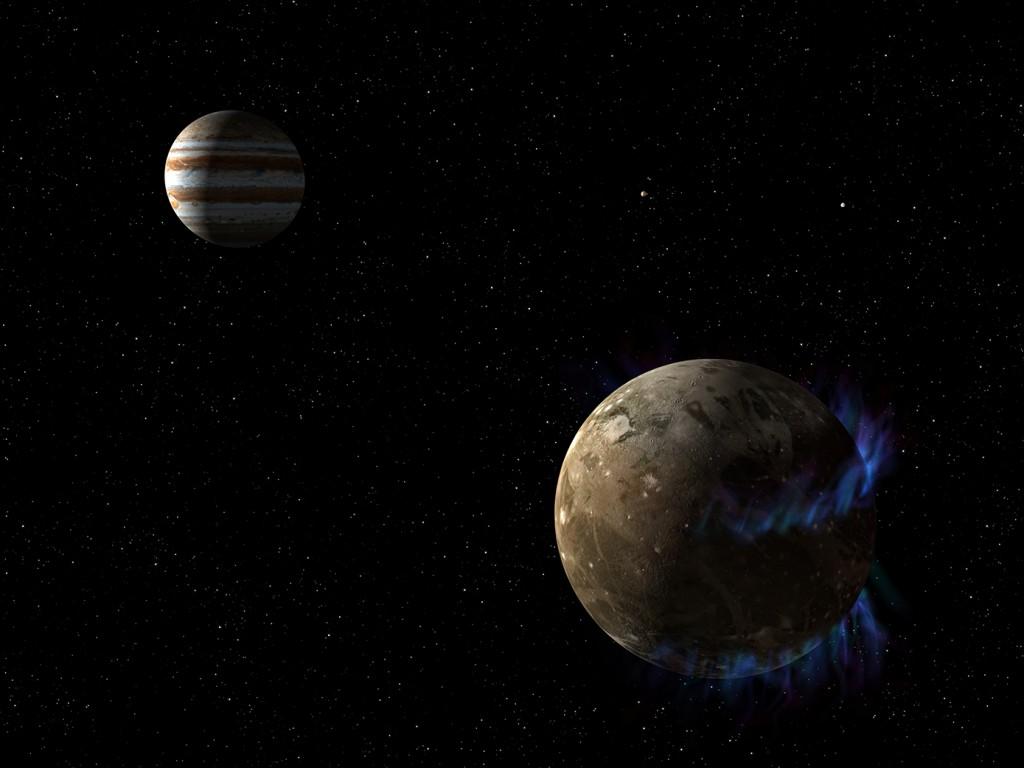 Илюстрацията показва луната на Юпитер Ганимед и аврората, която се поражда от магнитното му поле. Юпитер се вижда на заден план. Изображение: NASA/ESA