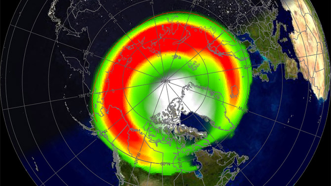 Симулация, показваща въздействието на бурята и зоните, в които може да се наблюдава Северното сияние (най-активните в червено). Изображение: NOAA/Ovation