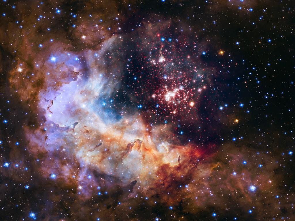 Красивото изображение на огромен куп от над 3000 звезди, което Хъбъл засне за рождения си ден. Снимка: NASA, ESA, the Hubble Heritage Team (STScI/AURA), A. Nota (ESA/STScI), Westerlund 2 Science Team